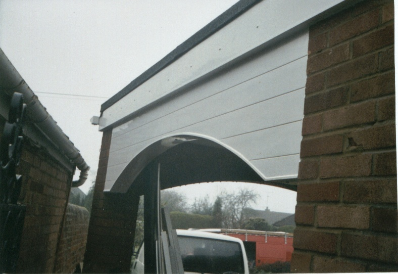 This example shows an external archway to a porch clad with custom-made UPVC products