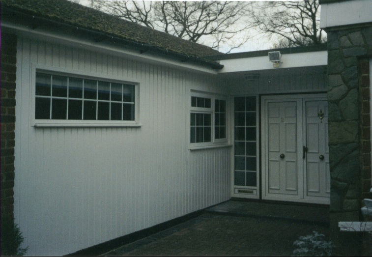This example shows a bungalow entrance with exterior wall and porch clad in UPVC products